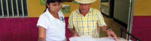 Fundación Natura staff helps a farmer NZDZ - header