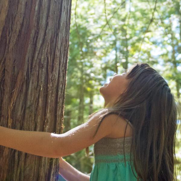 girl hugging tree - header