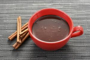 hot chocolate with cinnamon sticks - header
