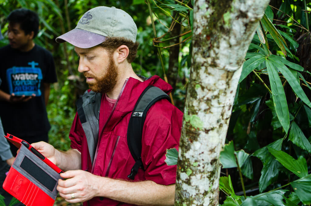 Rainforest Alliance Chief Scientist Jeffrey Milder collects data on a cocoa farm in Indonesia.