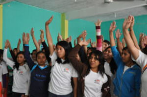 Students in Mexico raising their hands