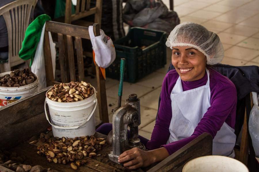 Woman in Tres Islas Brazil Nut processing facility