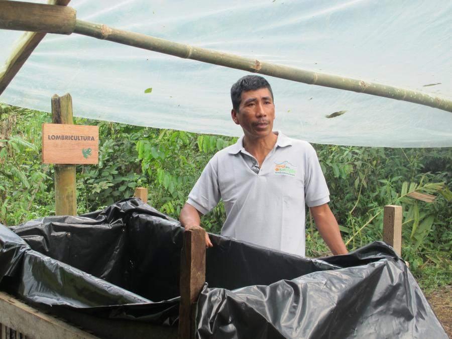 Community member shows vermiculture bin.